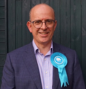 Councillor Andy Coles with a Conservative rosette